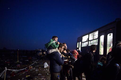 The Latest: Germany: Migrants can still come despite checks