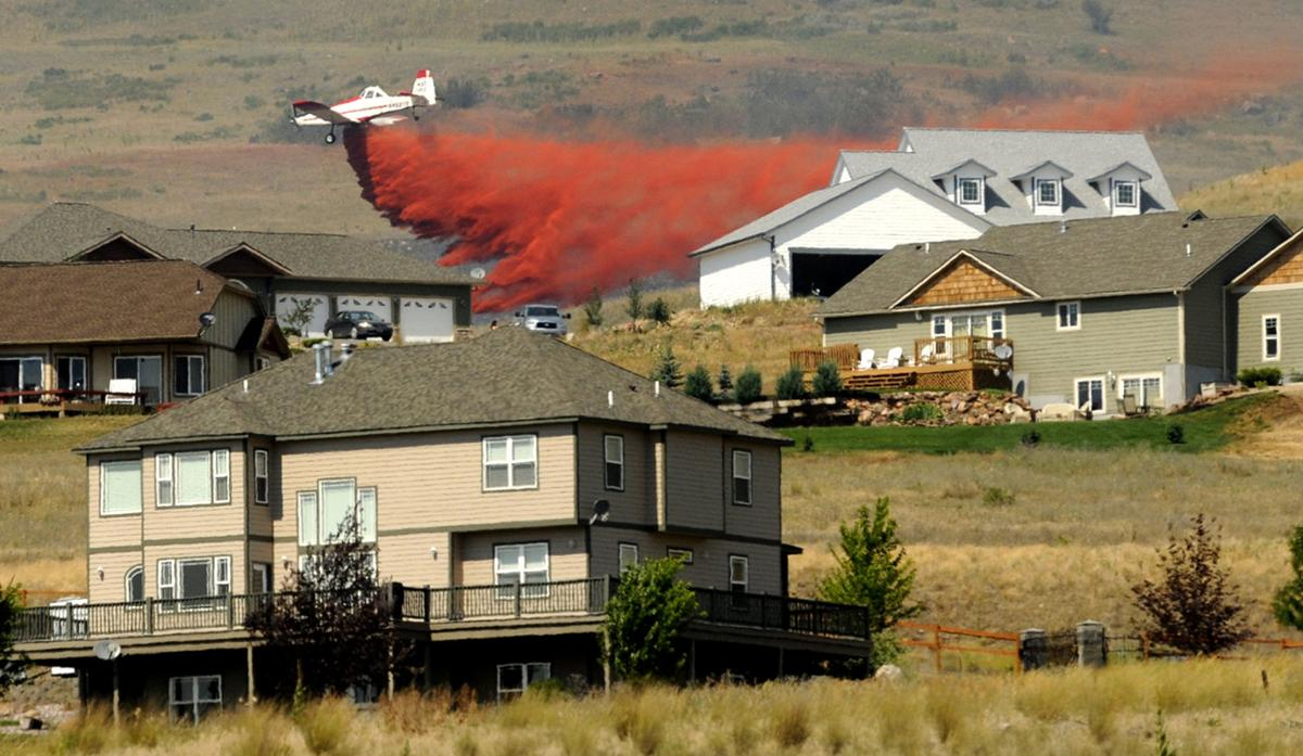 101118 houses in fire danger file kw.jpg