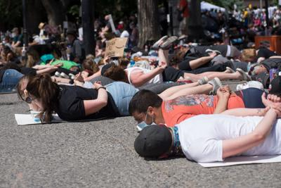 Protesters lie on their stomachs