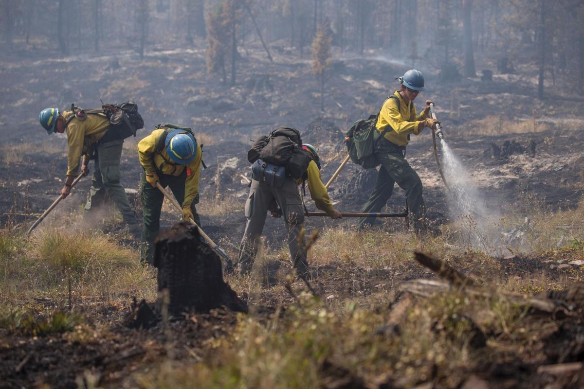 Firefighters work the Liberty Fire in early August.