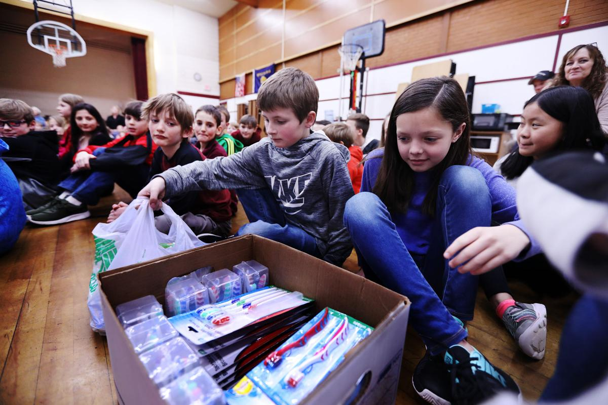Butte Central students donate toothbrushes to local dentist