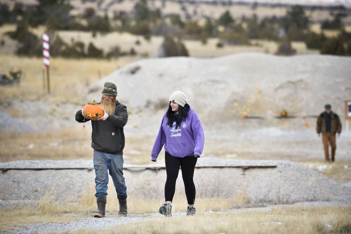 Participants retrieve a bullet ridden pumpkin Saturday that didn't explode the way it was supposed to.