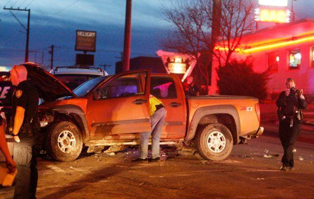 Emergency responders investigate the scene of a crash