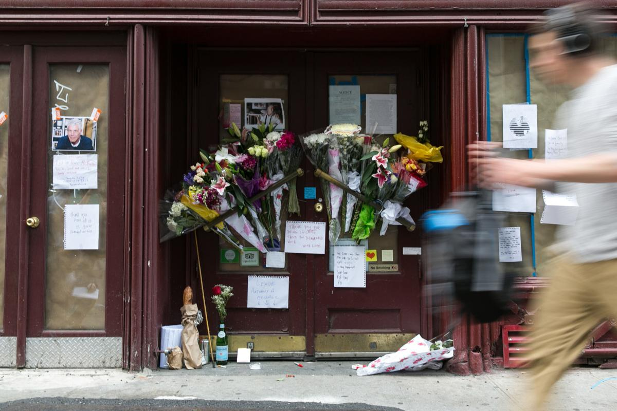 A memorial with flowers, notes, and pictures in memory for the late celebrity chef Anthony Bourdain in front of his former New York restaurant, Brasserie Les Halles, at 411 Park Ave South, in Manhattan, on Friday, June 8, 2018.