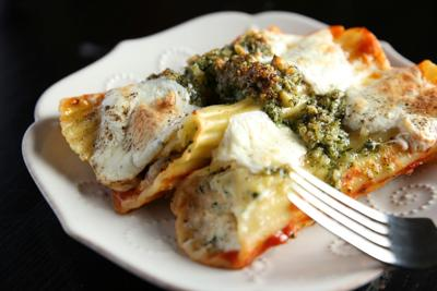 Saucy, cheesy stuffed manicotti with coppa and rustic pesto