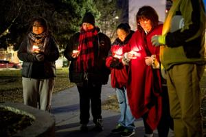 Mourners hold candlelight vigil for 5-year-old whose parents have been charged with the death