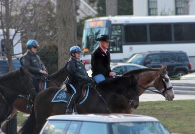 Zinke rides a horse to work