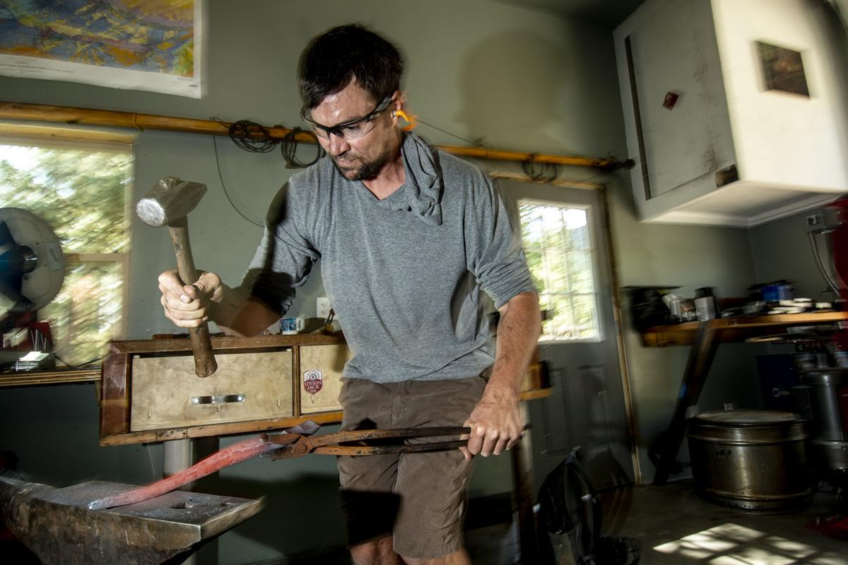 Mike Golins shapes a handle
