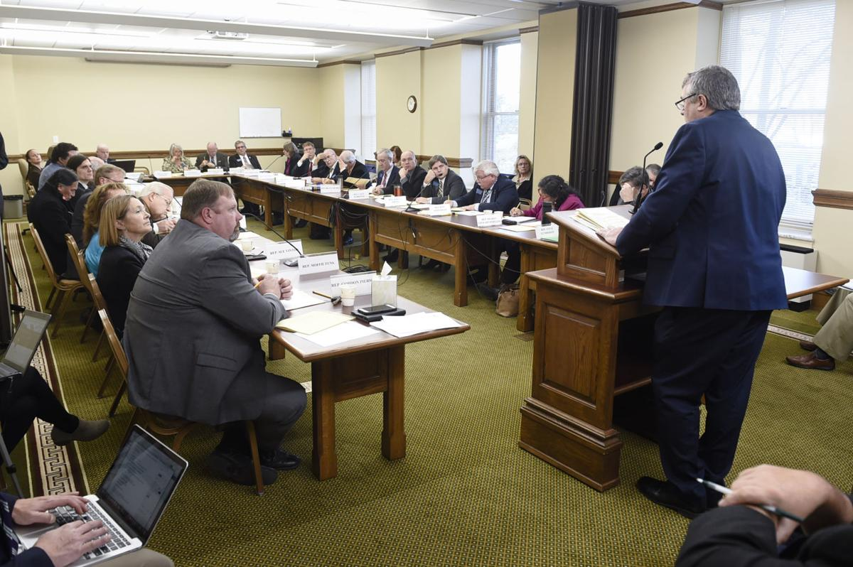 Kevin Braun, general counsel for Montana State Fund, right, testifies before the joint meeting of the House Business and Labor and Senate Business, Labor, and economic Affairs committees