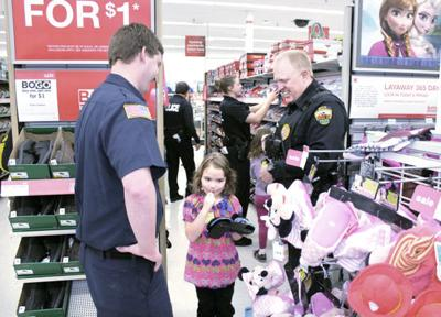 Butte-Silver Bow Firefighter Kolby Carter, left, and Police Officer Ben Rauch