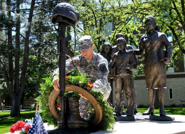 Cadet Tysen Moy lays a wreath at the Fallen Soldier Memorial