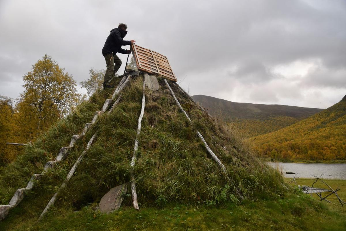 Mikael Vinka stands on top of a traditional goathie home at his Sami Ecolodge near Ammarnas, Sweden.