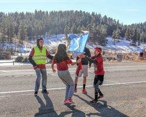 During historic relay, Northern Cheyenne wear red for Henny Scott, missing Native women