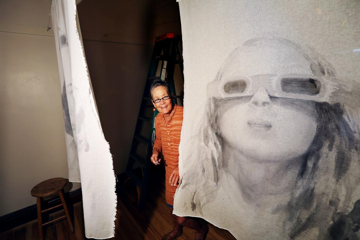 Artist uses portaits in interactive show opening inspired by women's equality issues