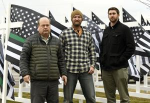 53 flags: Group constructs memorial to raise awareness of veteran suicides