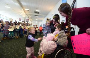 Girl paralyzed in crash welcomed home by fellow first-graders at Billings airport