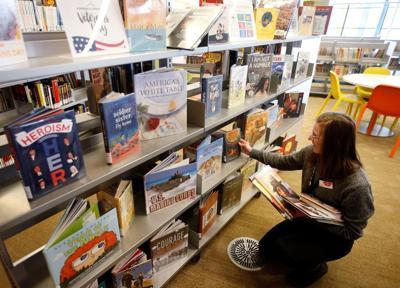 Librarian Molly Oullette shelves books