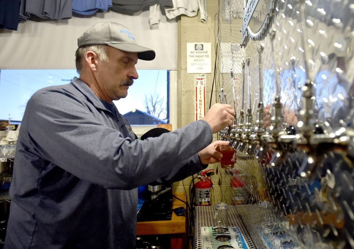 Owner Ben Boreson pours a beer