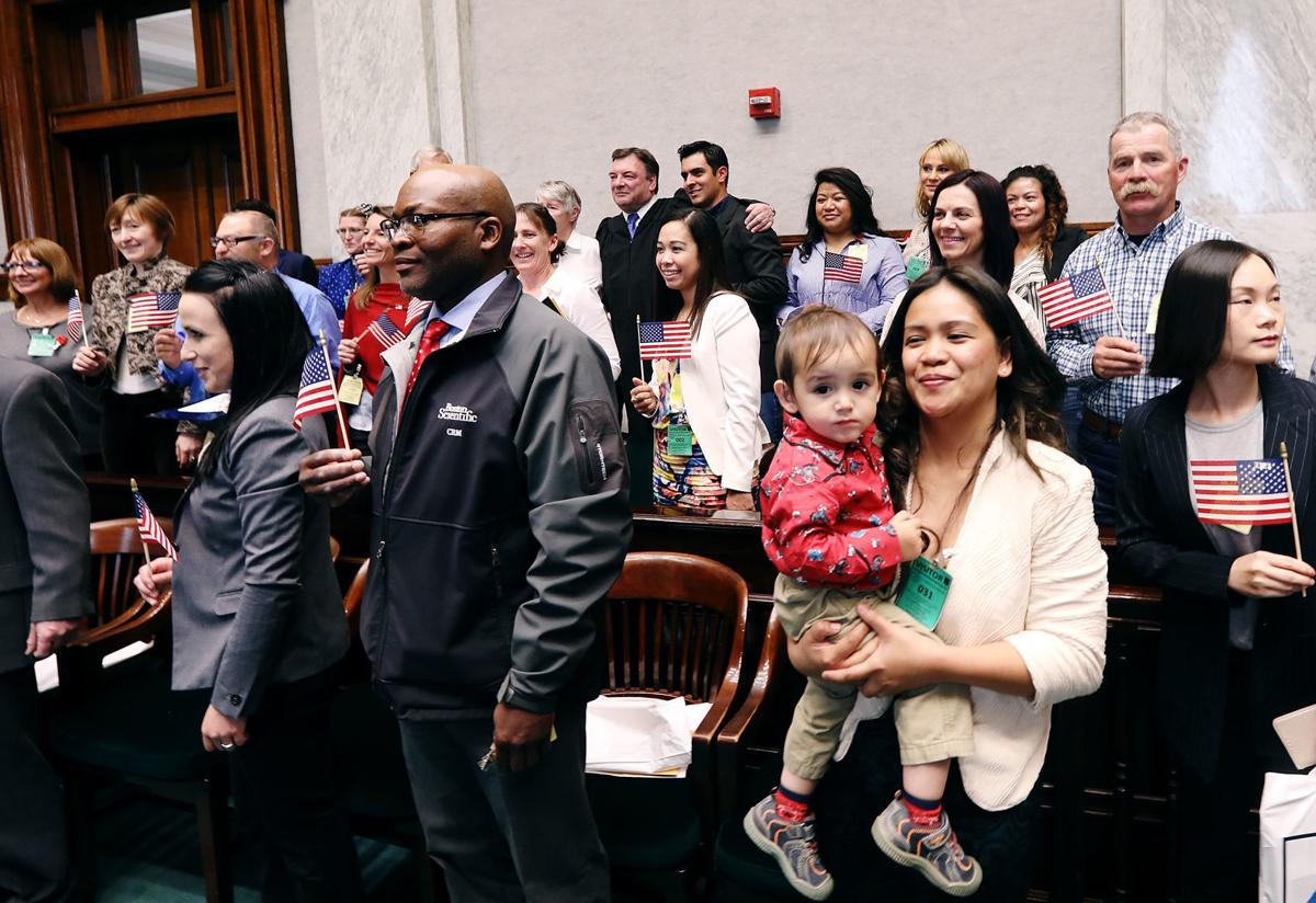 'It feels awesome'; 25 new American Citizens participate in Naturalization Ceremony