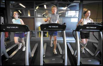 Coeds in condition - UM gym sees spike in use