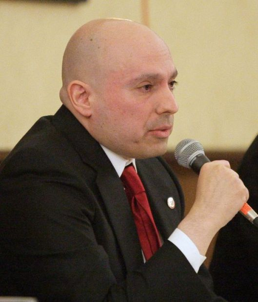 Drew Turiano answers a question in the debate Tuesday