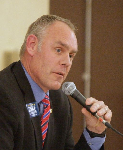 Ryan Zinke answers a question during a debate