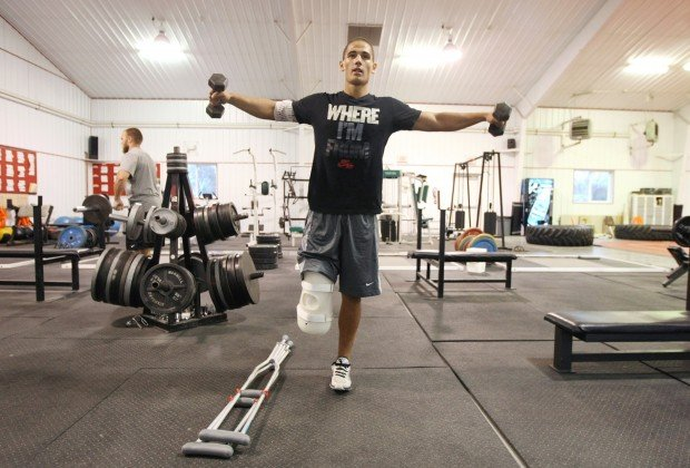 Koni Dole, 16, lifts weights in Worden