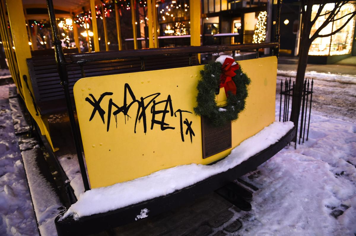 The Trolley Car with graffiti on the Walking Mall Monday night.