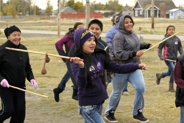 Sabrina Youpee and other participants in a traditional games clinic