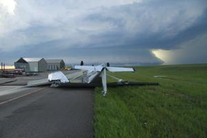 Severe thunderstorm in northeastern Montana causes power outages, damages buildings and planes