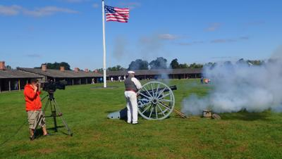 A re-enactor fires the cannon at Fort Atkinson.