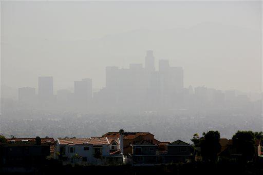 Massive blazes across dry West drain firefighting resources