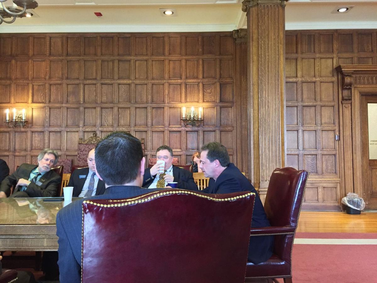 Governor and legislator meeting