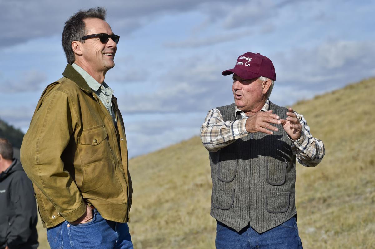Gov. Steve Bullock, left, talks with landowner Bob Rumney Wednesday during a tour of the Birdtail conservation easement 13 miles north of Cascade.