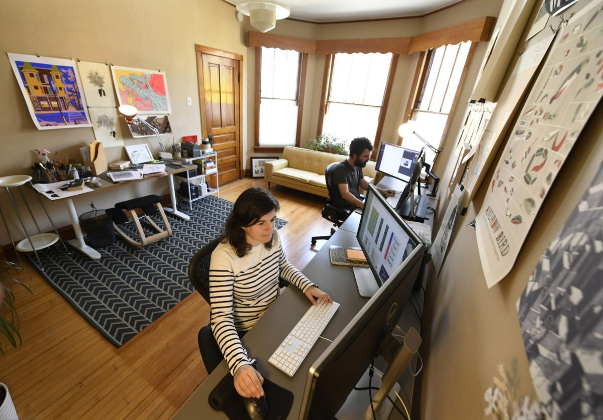 Graphic designer Jenny Volvovski works on May 1, 2018 in her home in Chicago, Ill.