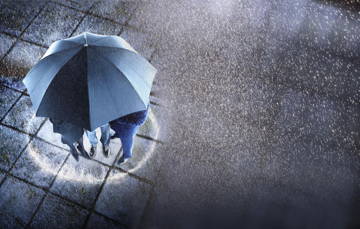 Huddled group under umbrella