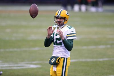 In this file photo, Green Bay Packers quarterback Aaron Rodgers warms up for a game against the Chicago Bears at Soldier Field on Jan. 3, 2021.