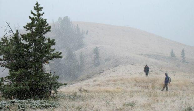 Hikers venture up a ridge