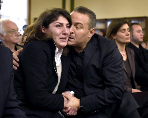 Gulcin and Celal Dede embrace