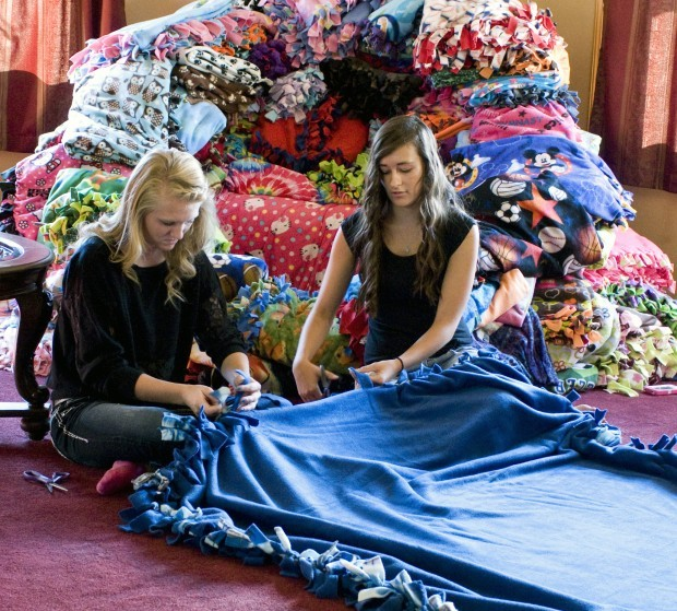 pair of sentinel high school students makes blankets for kids