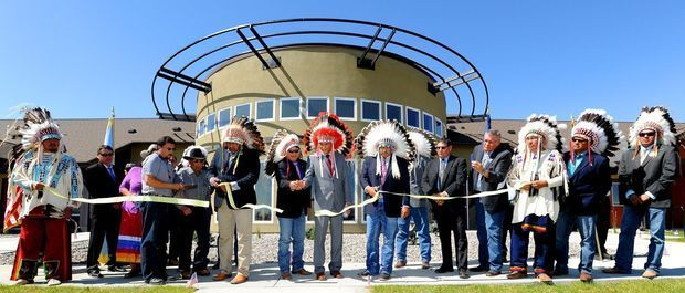 Crow officials hold a ribbon cutting ceremony