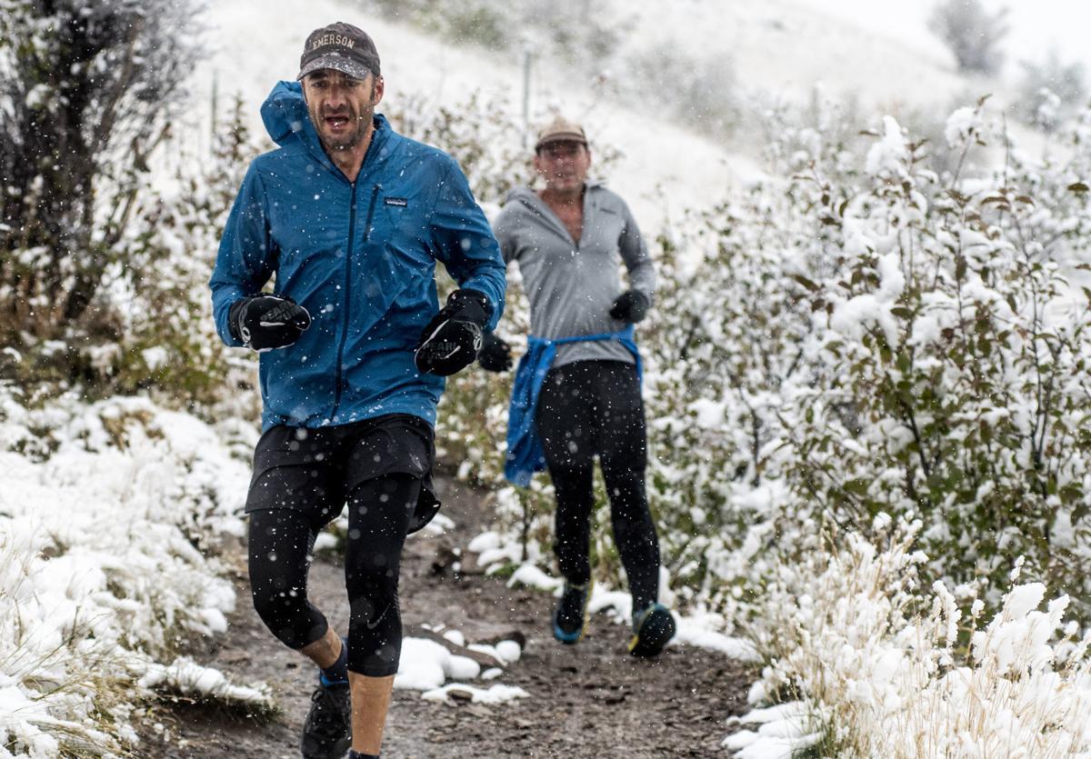 Mount Sentinel runners under snowfall