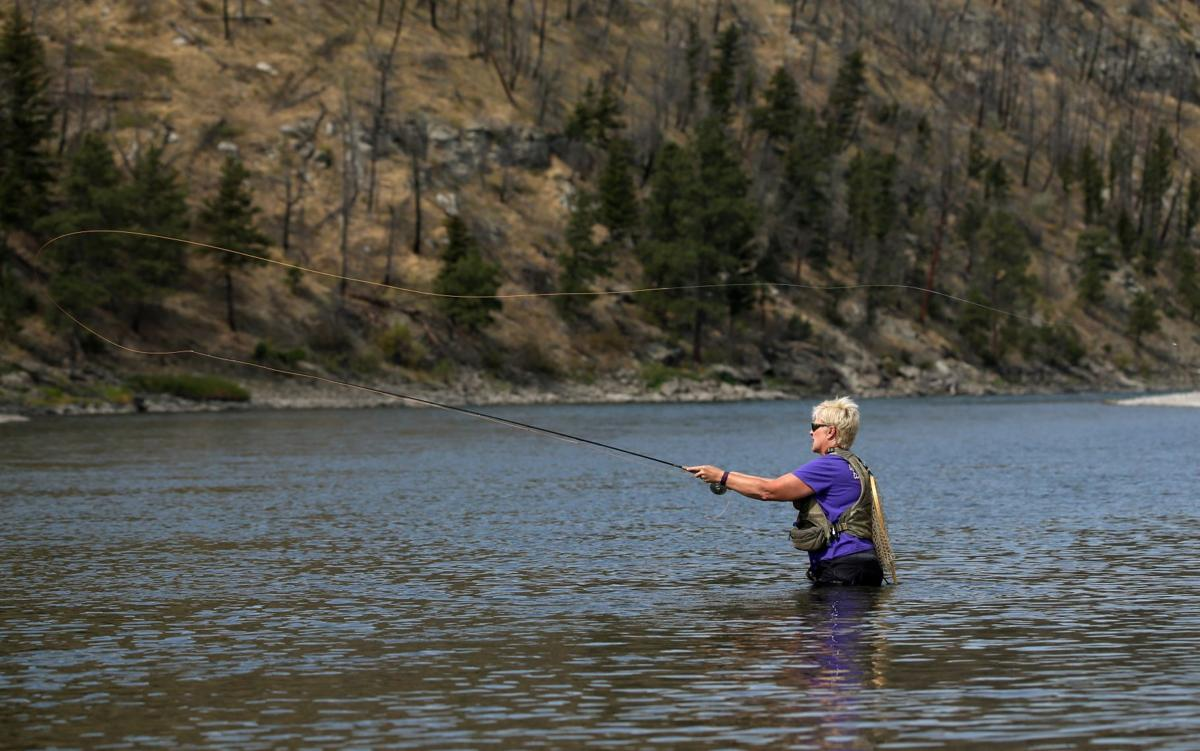 Trina Mailloux fishes in the Yellowstone River