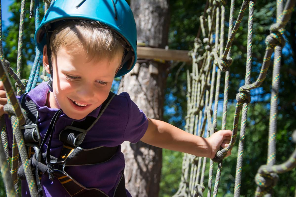 Child on a ropes course
