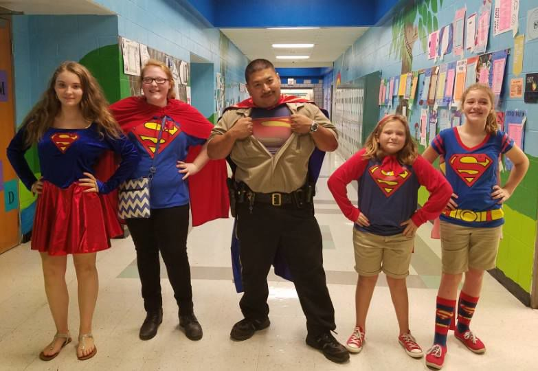 School Resource Officer Bud Phouang with students at West Middle School