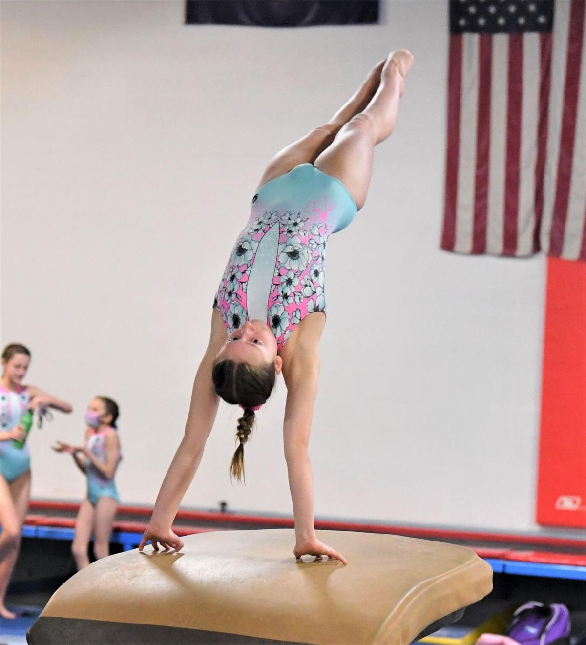 Ainsley Cheshire gets maximum extension on her vaulting effort.
