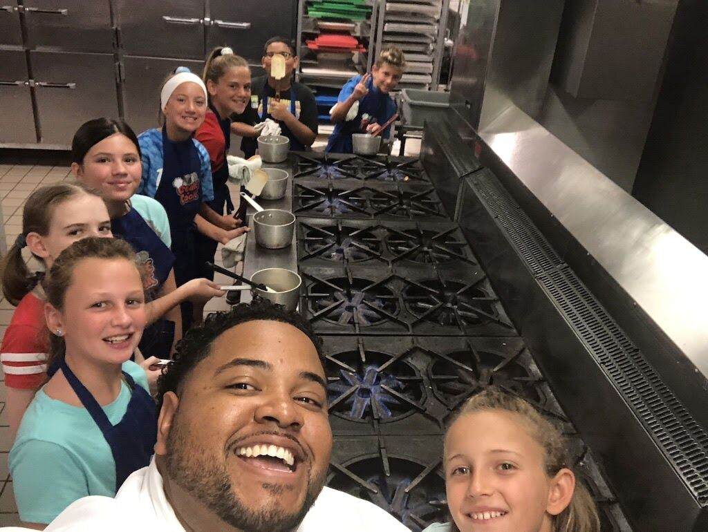 Chef Jarrett Young, a culinary instructor at Central Montco Technical High School, with students from the Create-a-Camp summer program he cofounded with Chef Maria Crann..jpeg