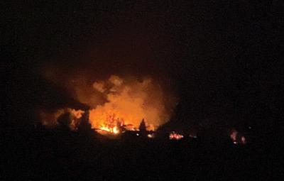 Smoke and flames can be seen on Uncompahgre Road