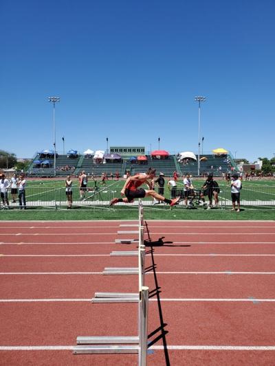 Motnrose boys track Isaac Renfrow running hurdles