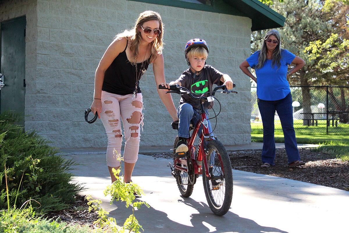 Local kids receive bicycles through MABA bike match program